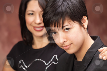 Attractive Multiethnic Mother and Daughter Portrait stock photo, Attractive Multiethnic Mother and Daughter Studio Portrait. by Andy Dean