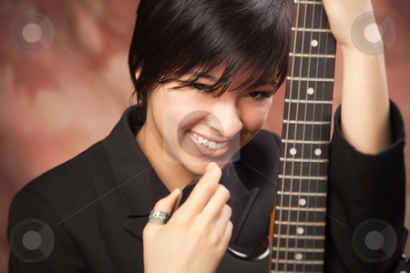 Multiethnic Girl Poses with Electric Guitar stock photo, Multiethnic Girl Poses with Her Electric Guitar. by Andy Dean