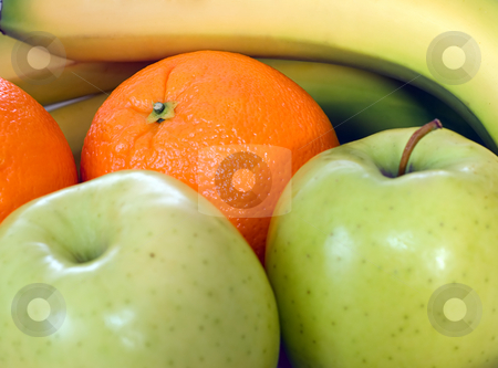 Fruit Background stock photo, A background made of assorted fruit including apples, oranges and bananas by Richard Nelson
