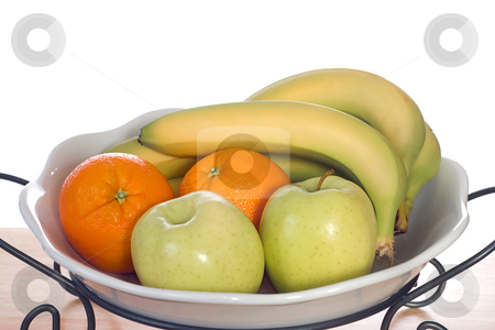 Bowl of Fruit stock photo, A white glass bowl full of bananas, oranges and apples, shot on a wooden board by Richard Nelson