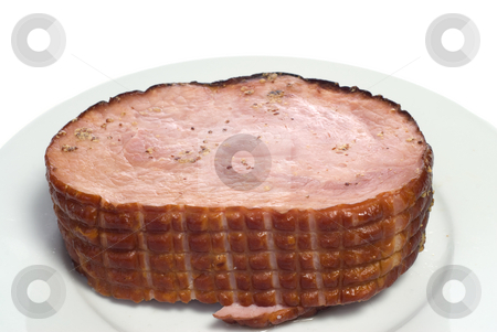 Sliced Ham stock photo, A cooked ham on a white plate, with spices on top, isolated against a white background by Richard Nelson