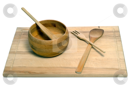 Wooden Utensils stock photo, A set of wooden utensils including a spatula, fork, spoon, and bowl, all sitting on a wooden cutting board, isolated against a white background by Richard Nelson