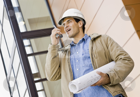 Young Male Construction Worker stock photo, Young male construction worker with blueprints.  Horizontally framed shot. by Jonathan Ross