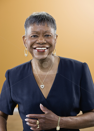 Older African American Woman Smiling stock photo, Older African American woman smiling at camera.  Vertically framed shot. by Jonathan Ross
