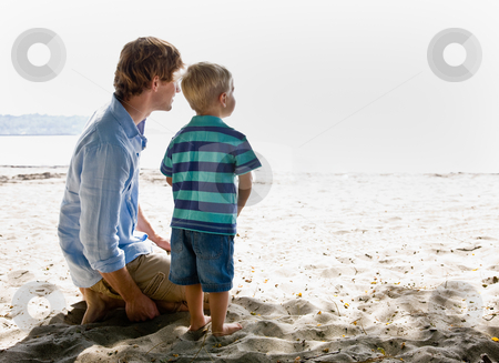 Father and son at beach stock photo, Father and son at beach by Jonathan Ross