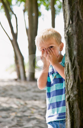 Boy hiding behind tree stock photo, Boy hiding behind tree by Jonathan Ross