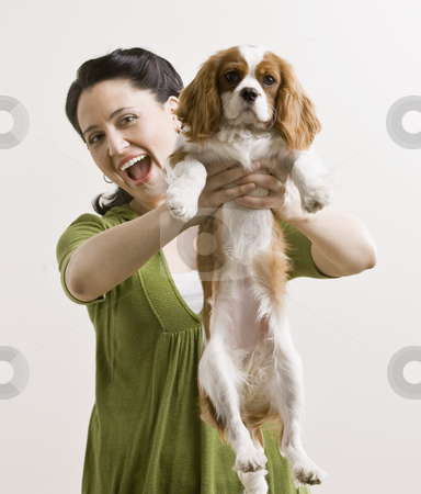 Adult Woman with Puppy stock photo, Adult female holding puppy. Vertically framed shot. by Jonathan Ross