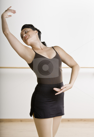 Mid Adult Female Dancer stock photo, Mid adult female dancer in pose. Vertically framed shot. by Jonathan Ross