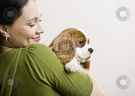 Adult Woman with Puppy stock photo, Adult female holding puppy. Horizontally framed shot. by Jonathan Ross