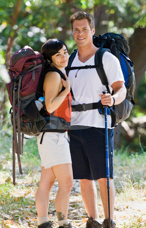 Couple hiking with backpacks stock photo, Couple hiking with backpacks by Jonathan Ross