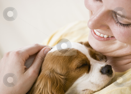 Young Woman Holding Dog stock photo, Young woman holding puppy. Horizontally framed shot. by Jonathan Ross
