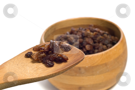 Raisin Ingredient stock photo, A wooden spoon full of raisins show of an ingredient for cookies or something, shot on white by Richard Nelson