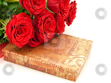 Red roses and gift stock photo, Red roses on a box with a gift by Sergej Razvodovskij