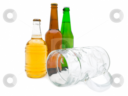 beer with glass stock photo, Hree multicolored bottles of beer with glass against the white background by Sergej Razvodovskij