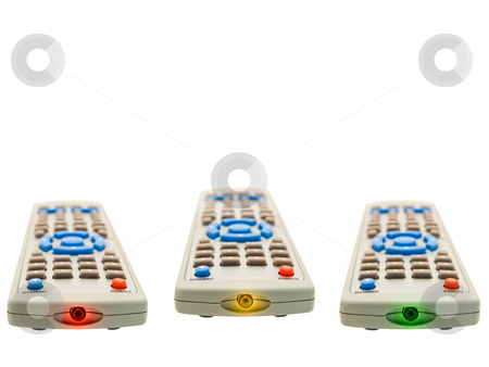 Remote controls stock photo, Three ligtning remote controls over the white background by Sergej Razvodovskij