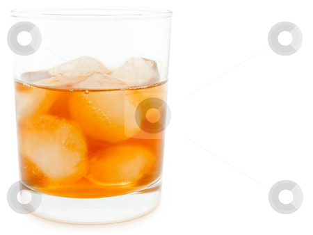 Glass of alcoholoic drink stock photo, Glass of alcoholoic drink with ice cubes by Sergej Razvodovskij