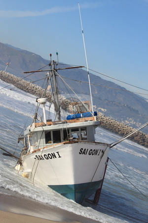 Fishing Boat Rescue stock photo, VENTURA, CA, USA - January 8, 2010 - The fishing boat SAI GON I ran aground after 4 people were rescued early morning. The rescue team tried to free the boat throughout the day January 8, 2010 in Ventura, CA by Henrik Lehnerer