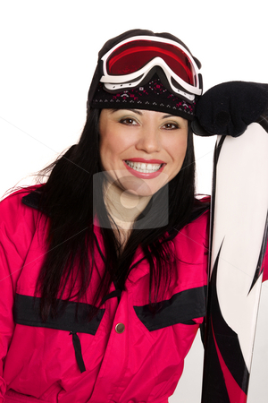 Happy Ski Girl stock photo, Female skier wearing ski gear casually leans on skis and smiles brightly. by Leah-Anne Thompson