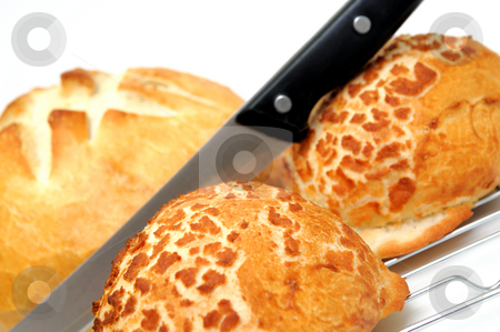 Bread And Rolls stock photo, A round loaf of sourdough bread, two dutch rolls with a knife to cut with by Lynn Bendickson