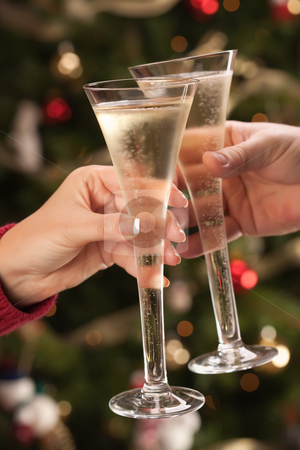 Man and Woman Toasting Champagne in Front of Lights stock photo, Man and Woman Toasting Champagne in Front of Decor and Lights. by Andy Dean