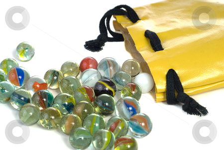 Marbles stock photo, A bunch of marbles spilling out of a bag, shot against a white background by Richard Nelson