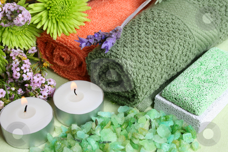 Spa Day stock photo, Spa Accessories setting with face cloths, candles and flowers by Vanessa Van Rensburg