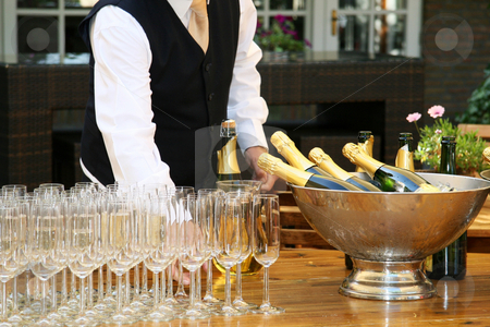 A waiter filled champagne glasses stock photo, A waiter filled champagne glasses by Christine Langer-Pueschel