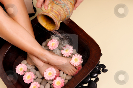 Pampered feet pedispa stock photo, A woman enjoys a soothing foot spa pedispa by Leah-Anne Thompson