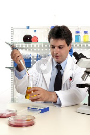 Laboratory pharmaceutical research stock photo, Laboratory scientist, chemist or pharmacist at work in a laboratory. by Leah-Anne Thompson