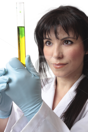 Female biologist at work stock photo, Biologist, in laboratory analyzing test tube research.   Focus to woman. by Leah-Anne Thompson