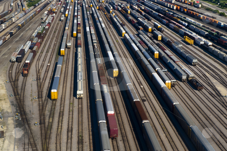Aerial View of Many Train Cars on Tracks stock photo, Image of an aerial view of many train cars on tracks by Greg Blomberg
