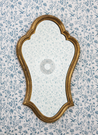 Golden Mirror Frame on Wall with Victorian Wallpaper stock photo, Golden Mirror Frame on Wall with Victorian Wallpaper by Brigida Soriano