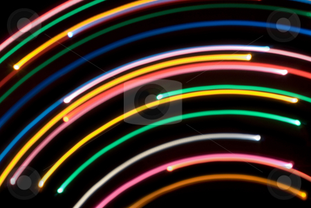 Colourful light arches stock photo, Abstract background composed of arcs of blurred coloured light by Stephen Gibson