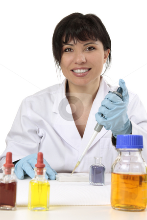 Friendly scientist, researcher, medical technician stock photo, Smiling search scientist using a manual fixed volume pipette and spotting plate.  She is looking straight ahead and smiling cheerfully. by Leah-Anne Thompson