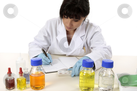 Scientist documenting results stock photo, Scientist makes notes and observations from research. by Leah-Anne Thompson
