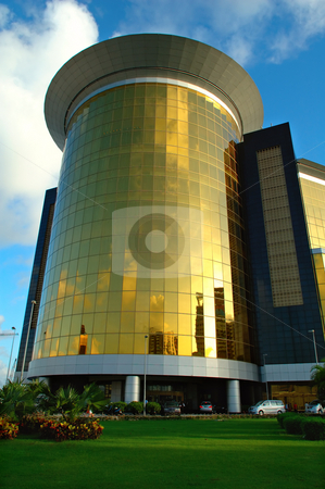 Golden building stock photo, Close view of golden commercial building over sky by Tito Wong