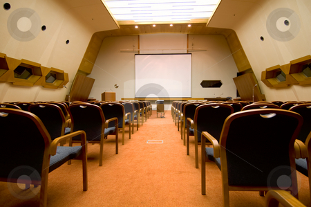 Rows of seats stock photo, The prespective of a conference or functional hall by Tito Wong