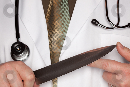 Doctor with Stethoscope Holding A Large Knife stock photo, Doctor with Stethoscope Holding A Very Large Knife. by Andy Dean