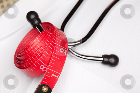Doctor with Stethoscope and Measuring Tape stock photo, Doctor with Stethoscope and Red Measuring Tape. by Andy Dean