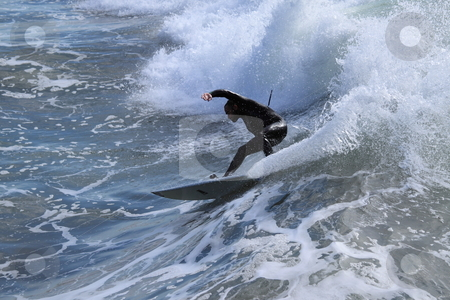 Surfer stock photo, VENTURA, CA, USA - January 10, 2010 - Surfer having fun throughout a high surf event January 10, 2010 in Ventura, CA by Henrik Lehnerer