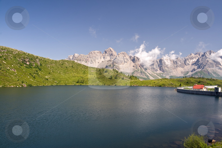 Cavia lake stock photo, Summer view of lake Cavia near San Pellegrino pass, Trentino, Italy by ANTONIO SCARPI