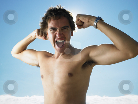 Young man flexing arm muscles,