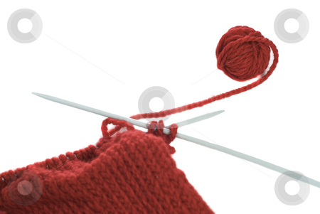 Knitting stock photo, A small ball of yarn being knitted into a cloth, shot on a white background by Richard Nelson