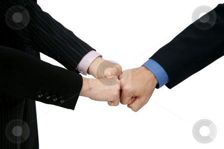 Teamwork Knuckle Bump stock photo, Image of three hands in a team building knuckle bump by Greg Blomberg