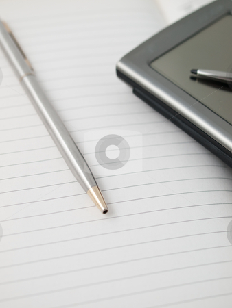 Notebook and pda stock photo, A pen and a pda on a notebook ready to take notes by Felix Manuel Cobos S??nchez
