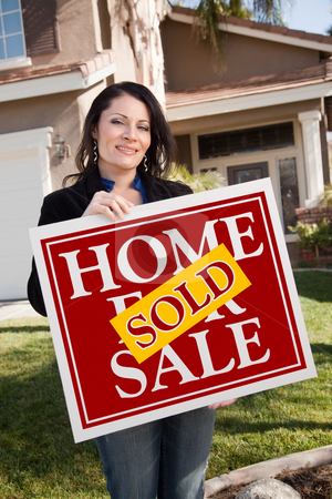 Hispanic Woman Holding Red Sold Real Estate Sign In Front of Hou stock photo, Happy Attractive Hispanic Woman Holding Red Sold Home For Sale Sign In Front of House. by Andy Dean