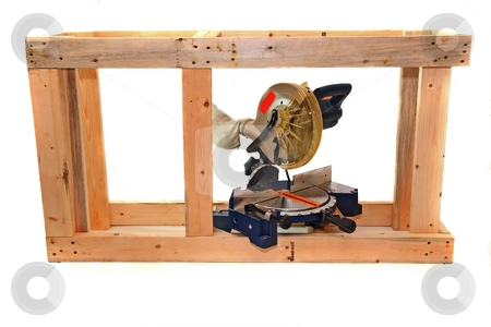 Wood Project stock photo, The building of an aquarium stand with a miter saw by Jack Schiffer