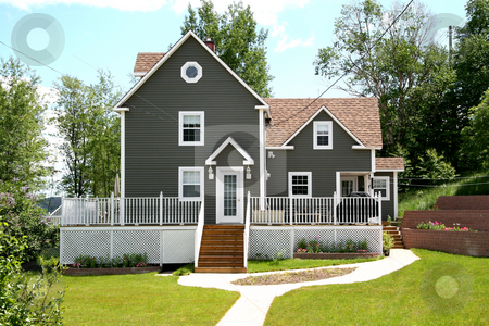 Modern Home in Rural Area stock photo, A Modern Home in a Rural Area by Melissa King