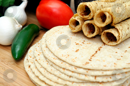 Corn Tortillas And Taquitos  stock photo, Taquitos with other natural ingredients including homemade tortillas, avocados, tomatoes, small sweet onions and jalapeno chilies by Lynn Bendickson