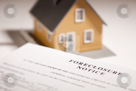 Foreclosure Notice and Model Home on Gradated Background stock photo, Foreclosure Notice and Model Home on Gradated Background with Selective Focus. by Andy Dean